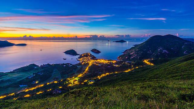 Dawn over a blue coast