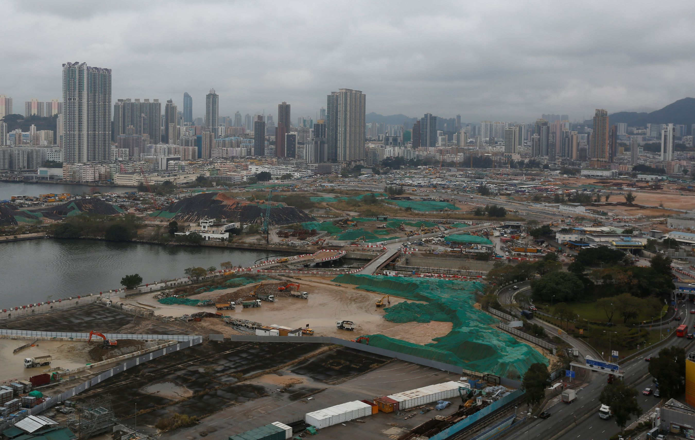 HNA Group's locally listed arm, Hong Kong International Construction Investment Management, proposed two-for-one rights issue to fund acquisition of sites at Kai Tak. Image from Reuters.