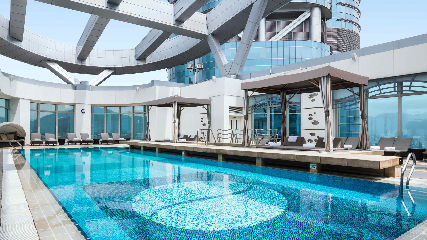 Best hotel swimming pools in hong kong spacious for Best swimming pools