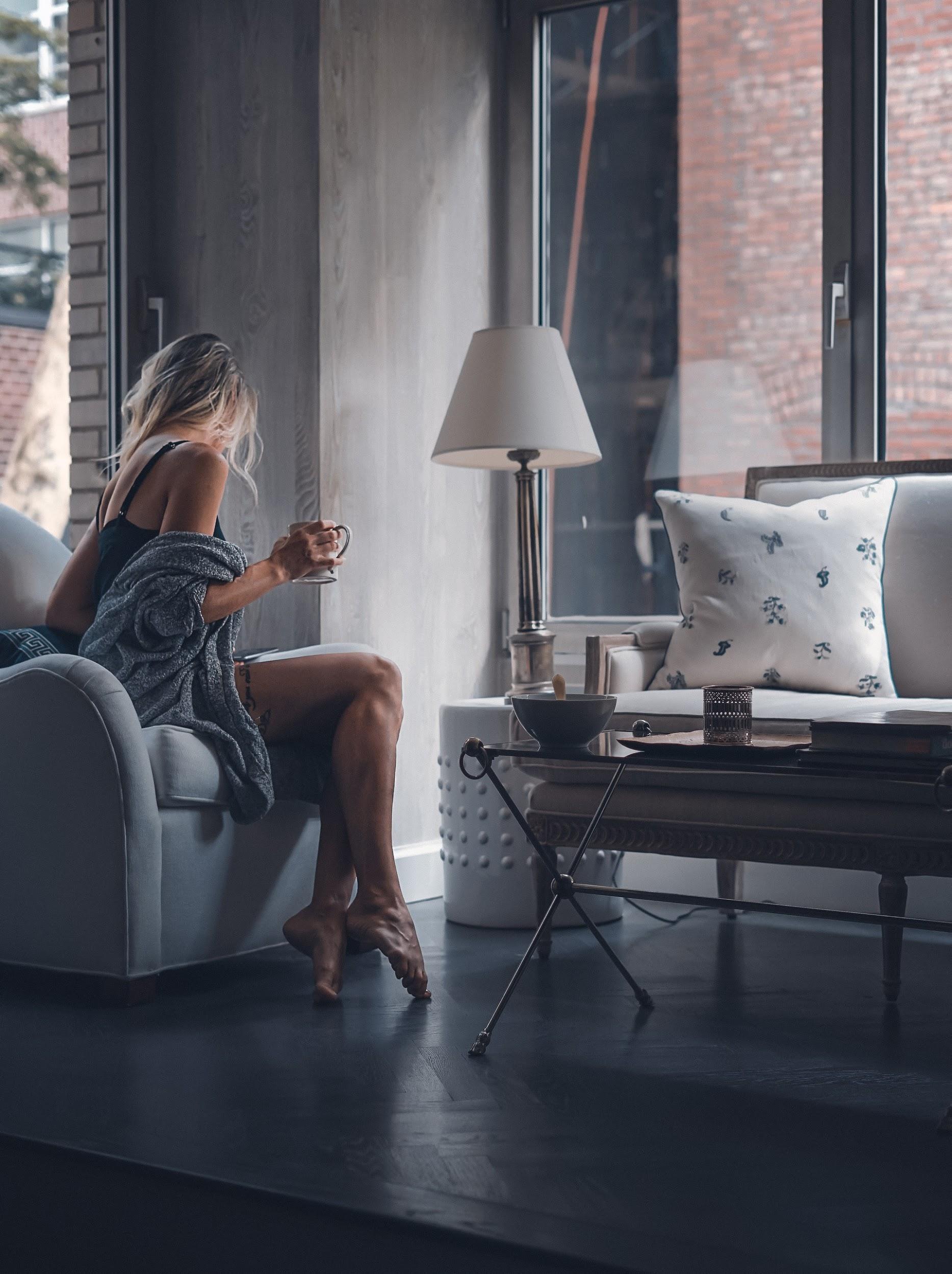 woman-sitting-on-sofa