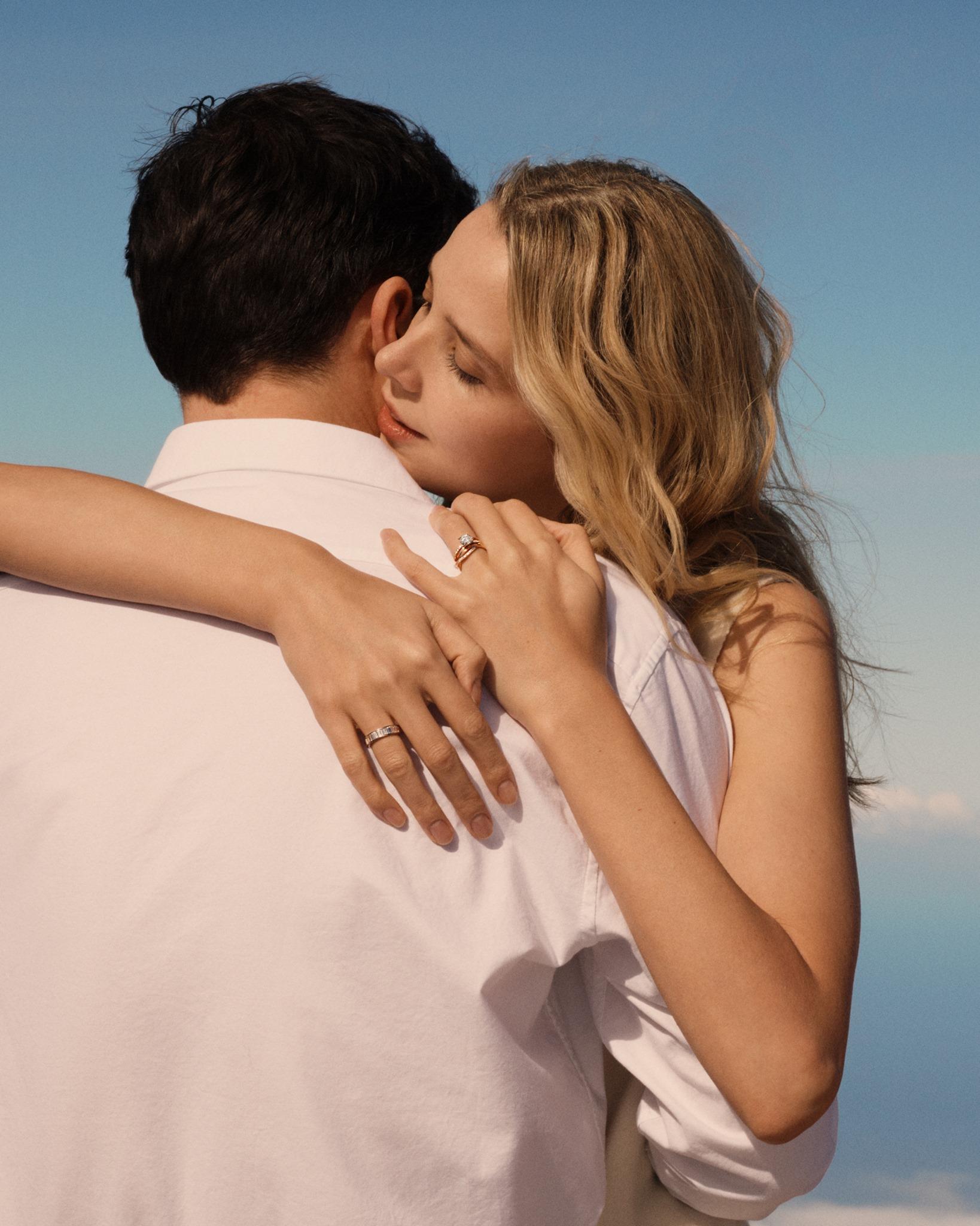 woman-wearing-diamond-ring-hugging-man